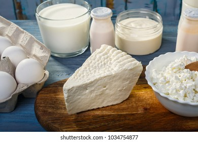 Farm dairy products on blue wooden table
