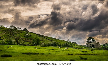 Farm and Dramatic sky over countryside on springtime in Forest of Bowland, Lancashire, England UK