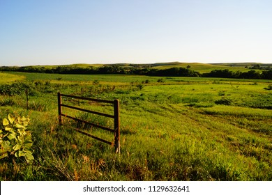 Farm fence and meadow in the Flint Hills of Kansas in the Midwestern United States.