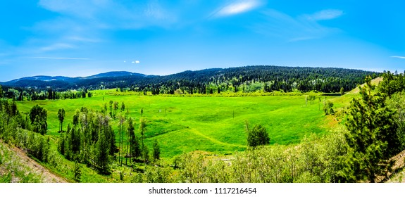 Farm fields surrounded by the Coastal Mountains along Highway 5A, the Kamloops-Princeton Highway, between the towns of Merritt and Princeton in British Columbia, Canada
