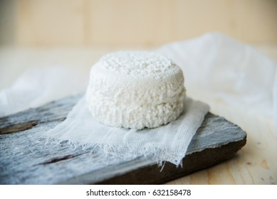 farm fresh cheese from goat's milk on a cutting board