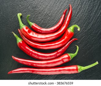 farm fresh chilli, red chilli, black background, group,random, selective focus