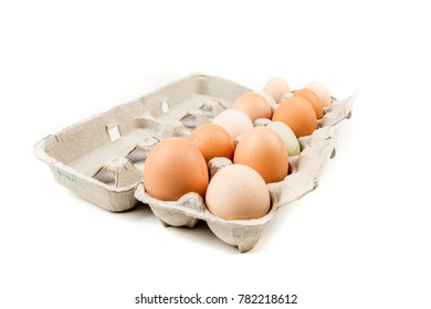 Farm fresh eggs in a carton on a white background