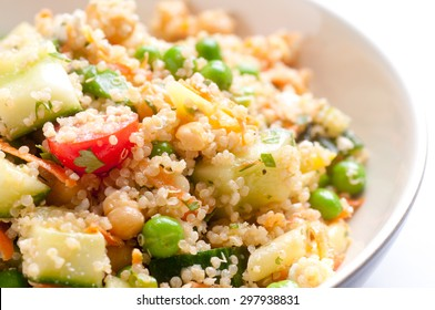 farm fresh healthy organic summer salad with quinoa and chickpeas, feta, cucumber and tomato