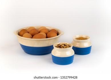 Farm Fresh Organic Free Range Eggs, Walnuts, Organic Sugar in Blue and White Bowls.