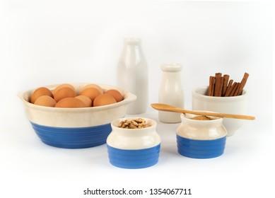 Farm Fresh Organic Free Range Eggs, Walnuts, Organic Sugar, Cinnamon, in Blue and White Bowls. Farm to Table