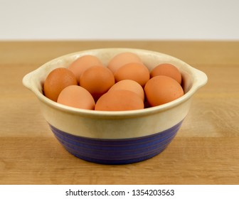 Farm Fresh Organic Free Range Eggs in Blue and White Bowl on Farm Table. Farm to Table