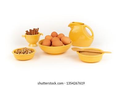 Farm Fresh Organic Free Range Eggs, Walnuts, Organic Sugar, Cinnamon, in Vintage Yellow Fiesta Ware with Large Pitcher. Farm to Table