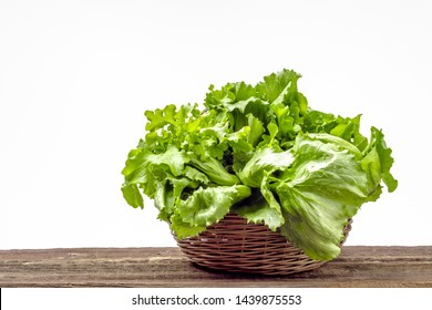 Farm fresh vegetables. Organic, fresh green lettuce on white background. Lettuce leaves on wooden table.