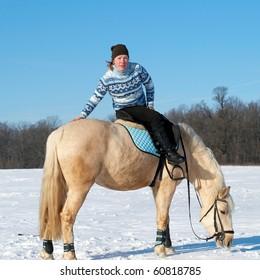 Farm girl sitting on horseback
