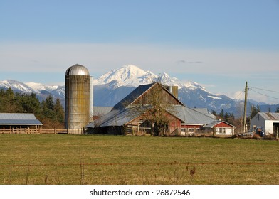 Farm house and barn with Mount Baker in the background