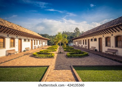 Farm house colonial style, stone pathway, Brazil
