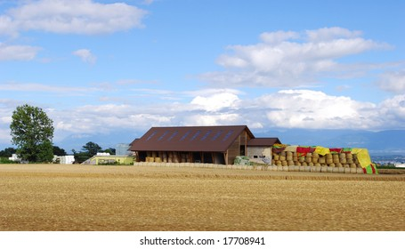 The farm house in the harvested fields