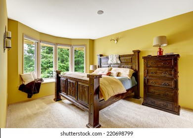 Farm house interior. Luxury bedroom interior. Beautiful wooden high bed with large dresser