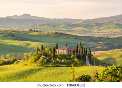 Farm house on a hill in Tuscany landscape