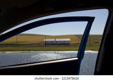 A farm house seen out of a car window in Hulunbuir, Inner Mongolia, China.