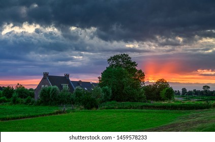 Farm house sunset silhouette landscape. Sunset farm house view. Sunset farm house silhouette. Farm house sunset scene
