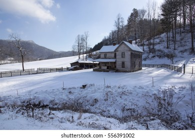 farm house in winter snow