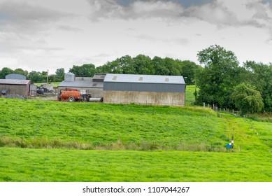 farm houses and slurry tank spreader, taken at Cavan, Co. Cavan, Ireland, in July, 2017.