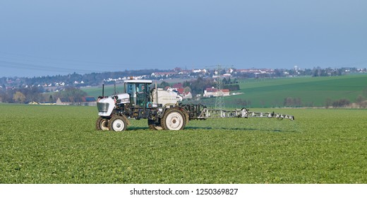 Farm implements / Goehren / Germany - April 2018: Self propelled field crop sprayer on a freshly sown field on the outskirts of Altenburg