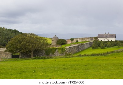 Farm labourer's cottages beside the walled garden at Mussenden House on the Downhill Demesne on the north coast of County Londonderry in Northern Ireland
