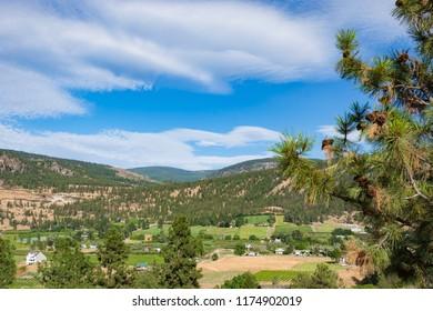 Farm land landscape on summer day in Okanagan valley