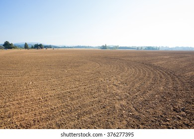 Farm land property in the country prepped and ready for a farmer or rancher to plant an agriculture crop.
