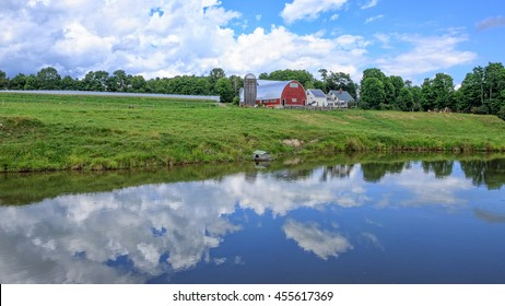 A farm landscape with duck pond in Vermont.
