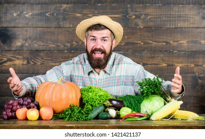 Farm market harvest festival. Sell vegetables. Man bearded farmer with vegetables rustic style background. Buy vegetables local farm. Locally grown crops concept. Local market. Homegrown vegetables.