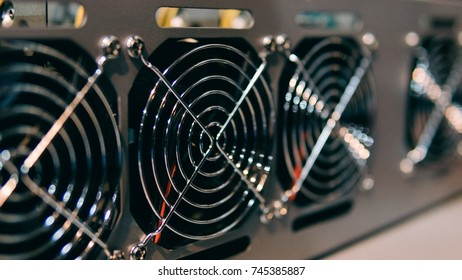 farm for mining crypto currency on video cards close-up. Device for mining crypto currency.Mining cryptocurrency.  Machines for mining cryptocurrency, bitcoin.