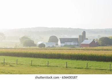 Farm in misty valley in Lancaster County, Pennsylvania