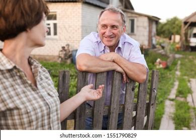 Farm neighbors talking at the fence