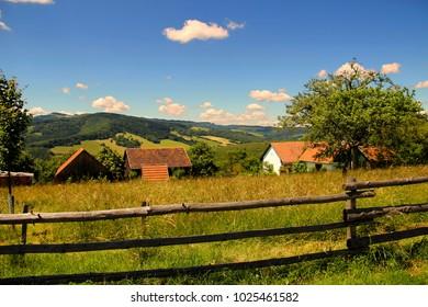 "farm on a hill fenced wooden fence made of logs (village ""Zitkova"", Czech republic, house goddes mrs. ""Irma Gabrhelova"")"