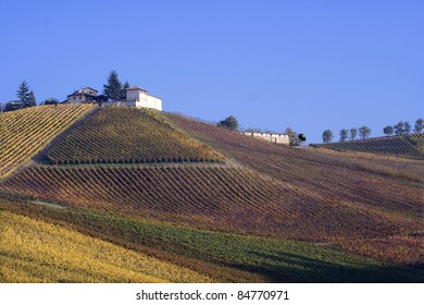 A farm overlooking the vineyards in autumn, Oltrepo Pavese, Italy.