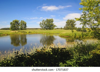 Farm pond in rural Alberta