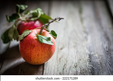 Farm raised apples on wooden background