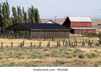 Farm or ranch with red barn, shelter, and fence