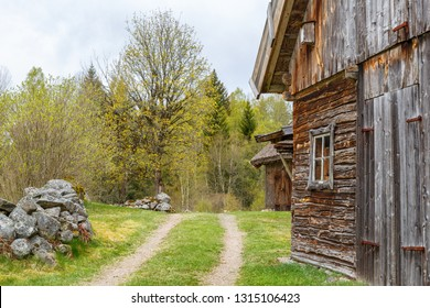 Farm road at an old timber barn in the spring