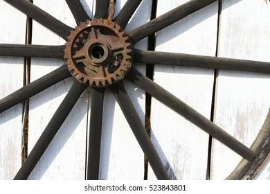 Farm still scene- Wood tire on white wood wall