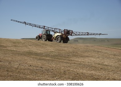 Farm tractor and crop sprayer in the Swartland region of South Africa