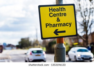 farmacy health centre directional road sign on road in uk