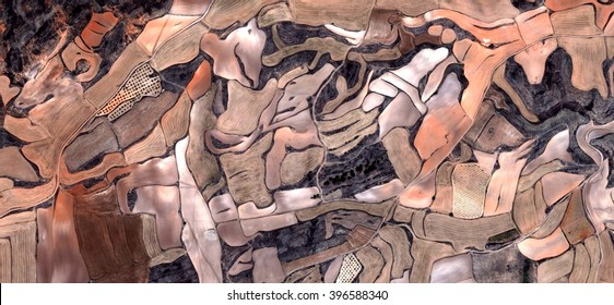the farm,allegory, tribute to Picasso, abstract photography of the Spain fields from the air, aerial view, representation of human labor camps, abstract, cubism, abstract naturalism,