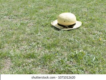 Farmer Amish Boy's Hat on Grass at the Farm