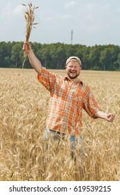 Farmer in cap standing at field