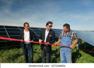 Farmer and conservationists cutting red tape at Photovoltaic power plant in Rott, Bayern, Germany