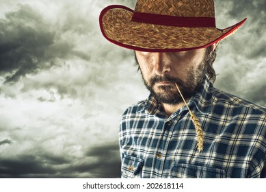 Farmer with cowboy hat and wheat straw in his mouth