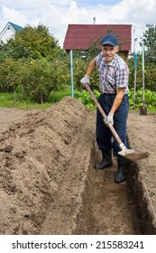 Farmer digging the earth to build a deep bed of in the garden