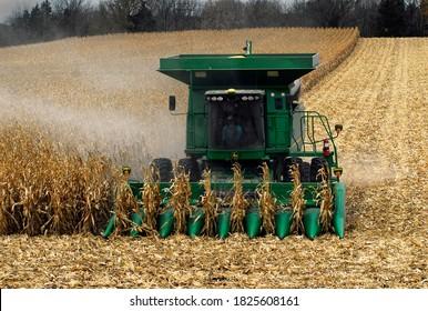A farmer drives a large John Deere combine to harvest a field of corn in Fairmont Minnesota 10-01-20.