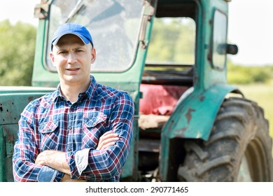farmer driving tractor in the countryside
