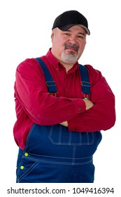 Farmer in dungarees standing sneering at the camera with folded arms and a supercilious expression isolated on white